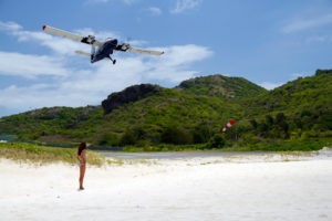Watch the planes take off from the beach at St. Barths