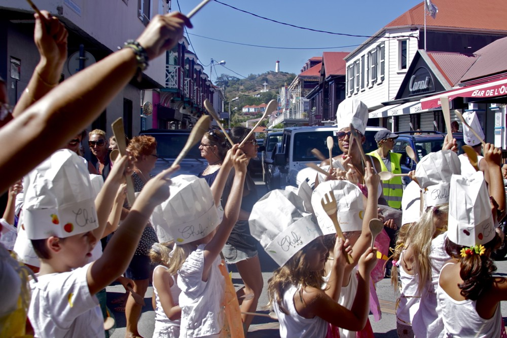 An army of mini chefs takes to the streets, wooden spoons in hand.