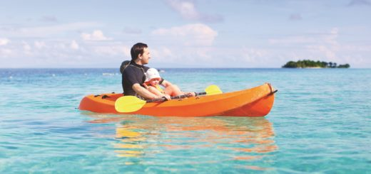 Father and daughter kayaking on Caribbean family vacation