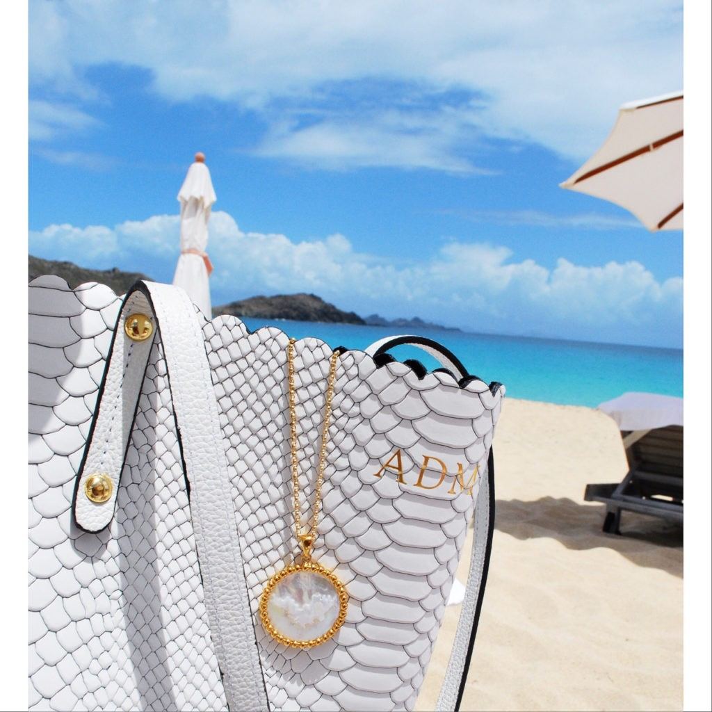 OUR ST. BARTHS PENDANT & WHITE PYTHON WAVERLY TOTE.