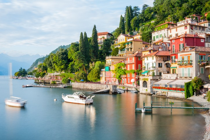 Panoramic view of Lago di Como in Northern Italy and the beautiful village of Varenna at sunset, Villas in Italy