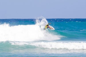 Warm, turquoise water makes the surf very inviting.