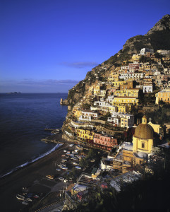 WIMCO Villas, View of the city of Positano, with fishing boats on the beach, Coastal Italy.