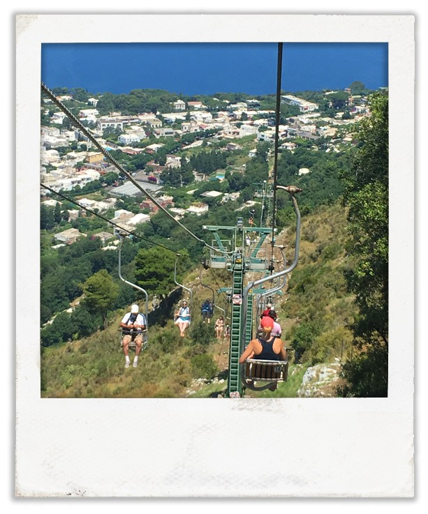 Taking the chairlift down from Monte Solaro