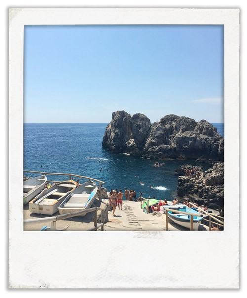 The view from Lido del Faro restaurant, Capri. Kids jump off the rocks in front.