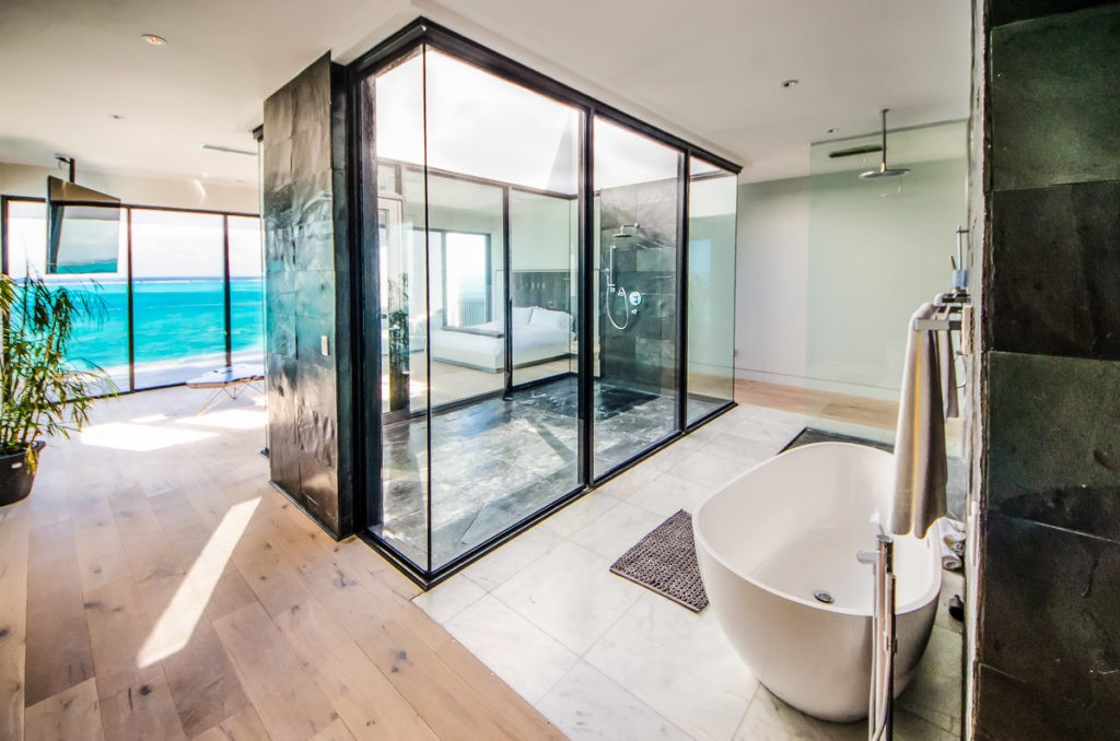 The master bedroom features a rain shower