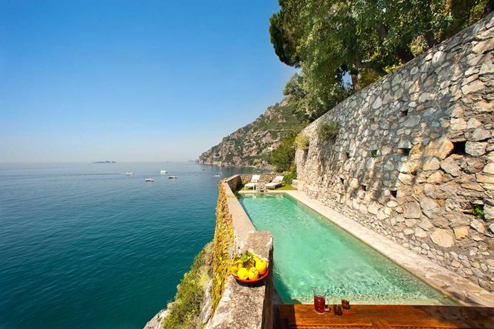 Two bedroom water front villa on the Amalfi Coast in Italy with a pool overlooking the sea.