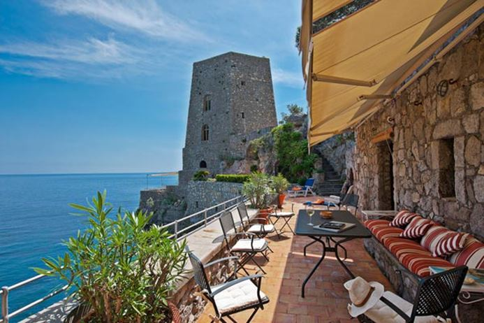 Waterfront Villa on the Amalfi Coast of Italy with spectacular views and dining area on the deck.