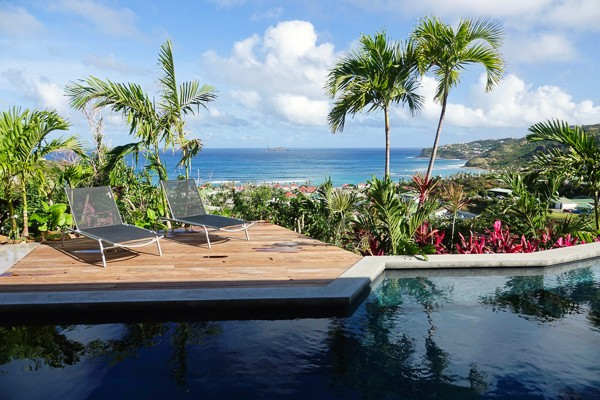 Two bedroom villa situated deep in the hills of Lorient, St Barths with panoramic ocean and hillside views.